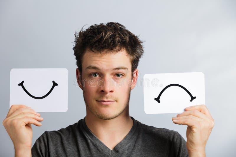 Portret osoba Trzyma Szczęśliwą i Nieszczęśliwą nastrój deskę obrazy stock