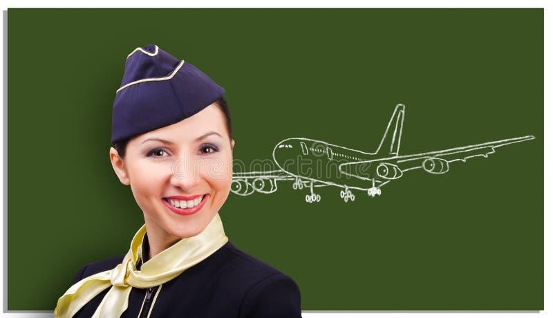 Portret piękna rozochocona stewardesa na tle deska zdjęcie stock