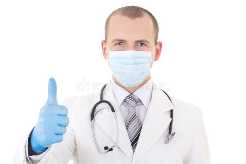 Portret potomstwo lekarka w maskowym i błękitnym rękawiczek aprobat isola zdjęcia royalty free