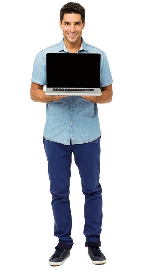 Portret Promuje laptop Ufny mężczyzna fotografia stock