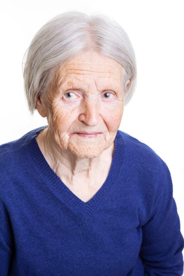 Portret przyglądający przy kamerą nad bielem starsza dama up zdjęcia royalty free