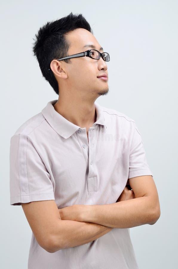 Portret przypadkowego Azjatyckiego mężczyzna przyglądająca strona zdjęcia royalty free