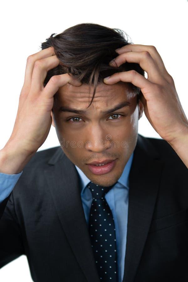Portret sfrustowany biznesmen z głową w ręce zdjęcia stock