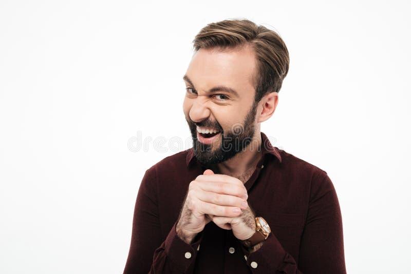 Portret sneaky brodaty mężczyzna planowanie coś zdjęcie royalty free