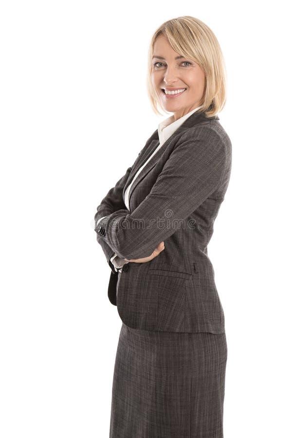 Portret: Succesvolle geïsoleerde oudere of rijpe blonde businesswoma stock afbeeldingen