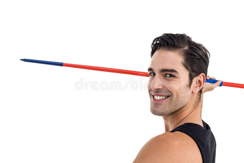 Portret szczęśliwa męska atlety mienia darda zdjęcia stock