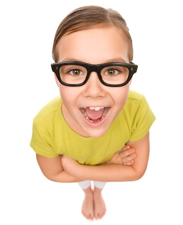 Portret szczęśliwa mała dziewczynka jest ubranym szkła zdjęcie royalty free