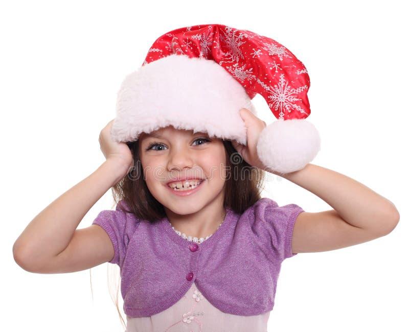 Portret szczęśliwa mała dziewczynka w Santa kapeluszu zdjęcie stock