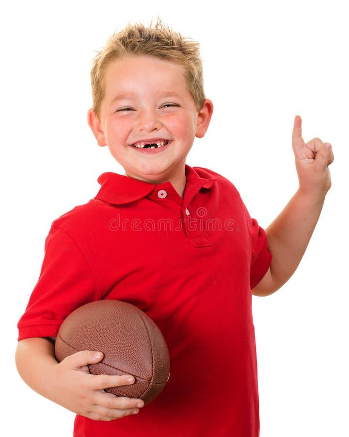 Portret szczęśliwy dziecko z futbolem odizolowywającym obraz stock