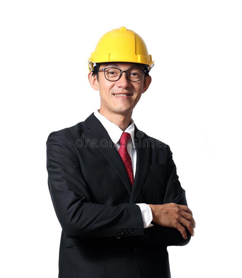 Portret szczęśliwy potomstwo inżyniera mężczyzna z ciężkim kapeluszem na białym bac zdjęcia royalty free