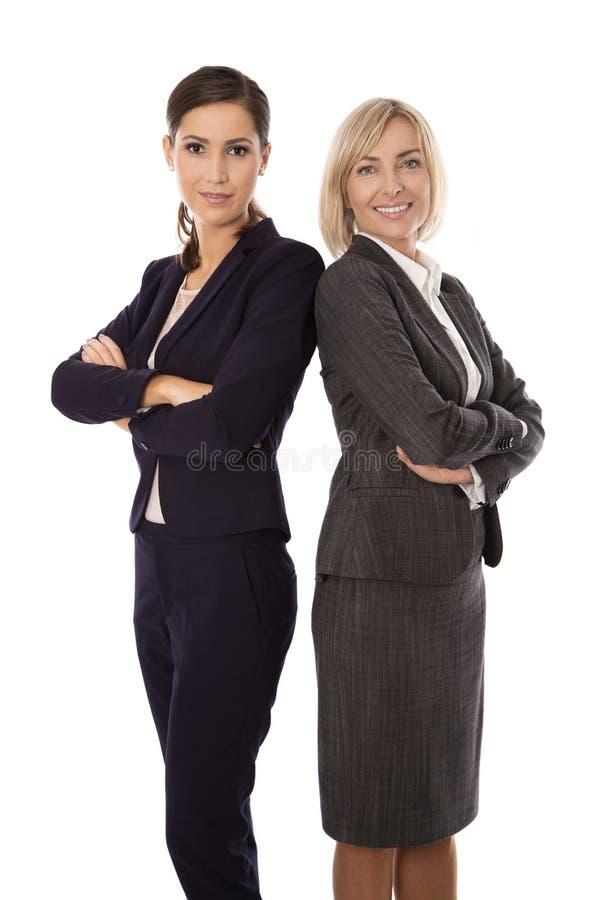 Portret: Team van twee geïsoleerde glimlachende en succesvolle businesswo stock afbeeldingen
