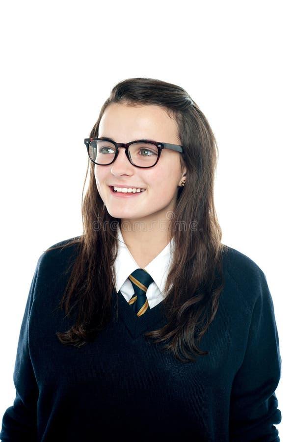 Portret uśmiechnięta młoda uczennica target126_0_ daleko od fotografia stock