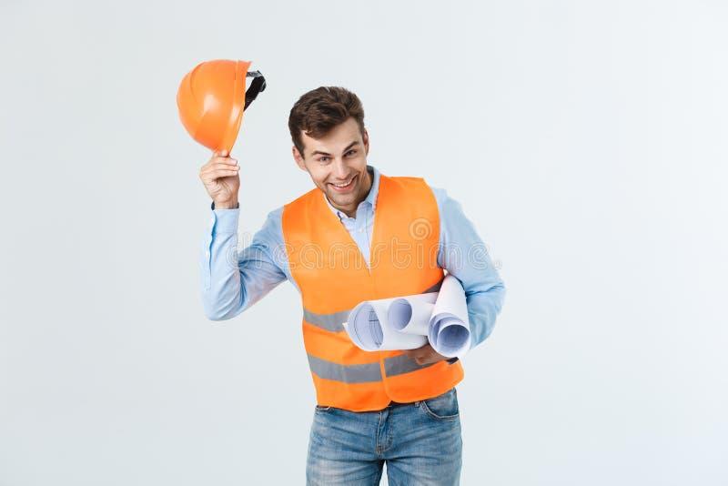 Portret ufny młody bussinessman architekt, inżynier ono uśmiecha się na białym tle lub obrazy stock