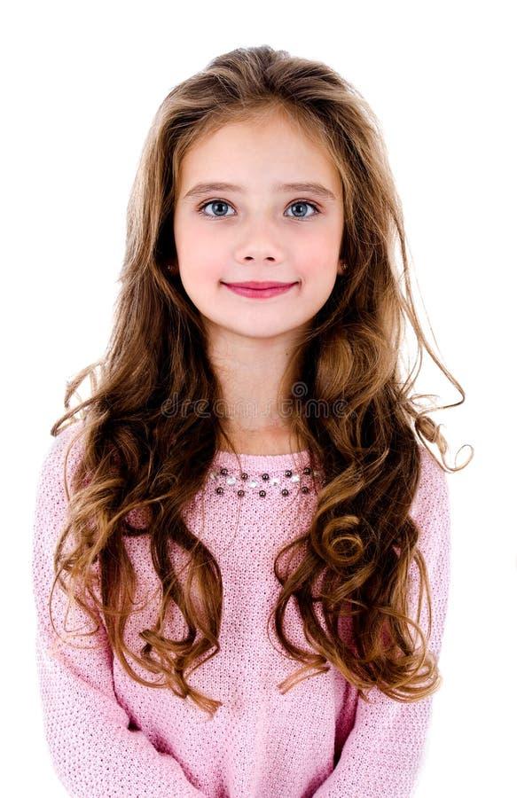 Portret van aanbiddelijk glimlachend die meisjekind op een wit wordt geïsoleerd stock foto