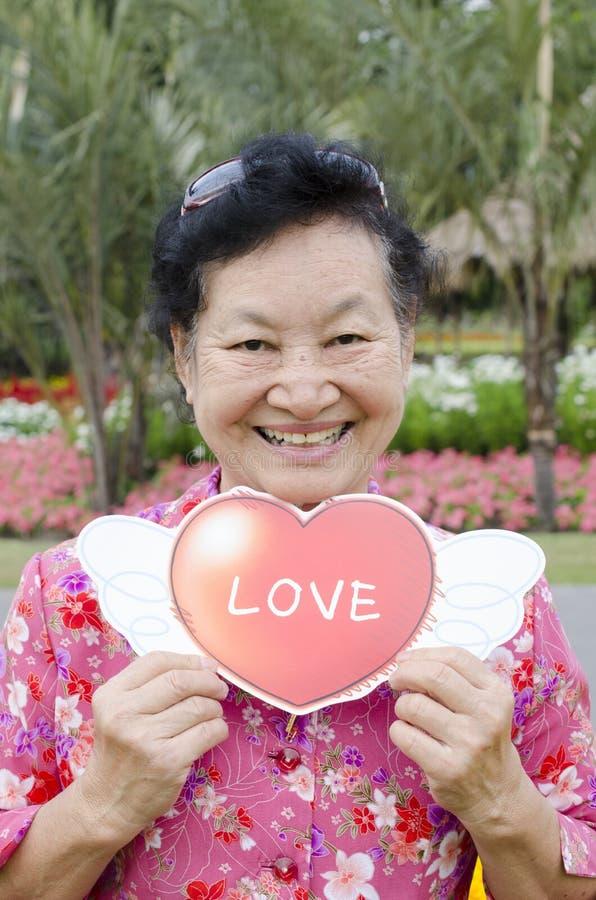 Portret van Aziatische bejaarden bij het park stock afbeelding