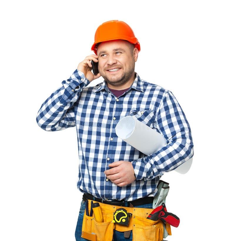 Portret van bouwbouwer op wit wordt geïsoleerd dat stock fotografie
