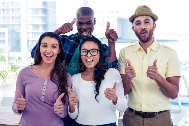 Portret van creatieve bedrijfsmensen met omhoog duimen royalty-vrije stock foto