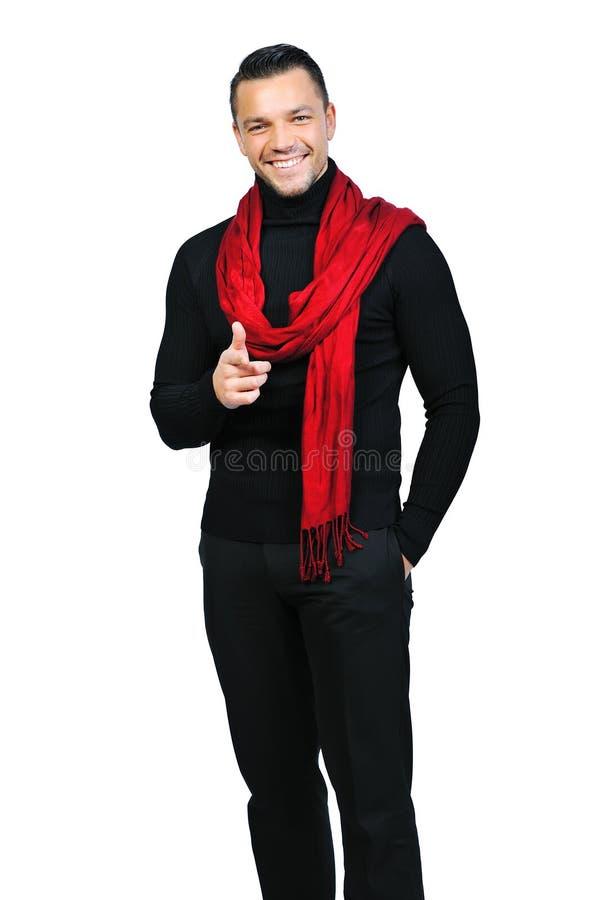 Portret van de glimlachende jonge mens die op u op wit richten royalty-vrije stock foto's
