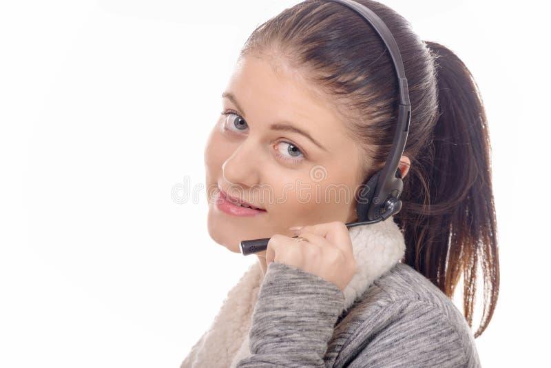 Portret van de glimlachende vrolijke exploitant van de steuntelefoon in hoofdtelefoon royalty-vrije stock fotografie