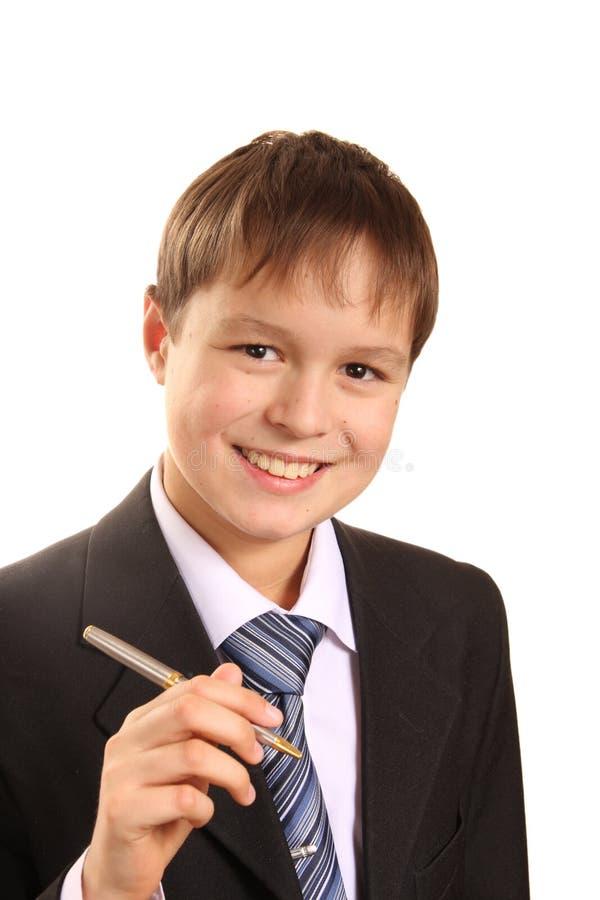 Portret van de holdingspen van de tienerjongen stock fotografie