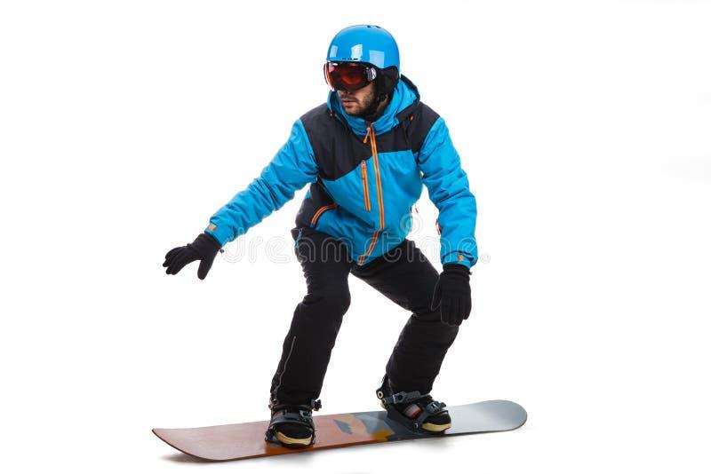 Portret van de jonge die mens in sportkleding met snowboard op a wordt geïsoleerd royalty-vrije stock afbeeldingen