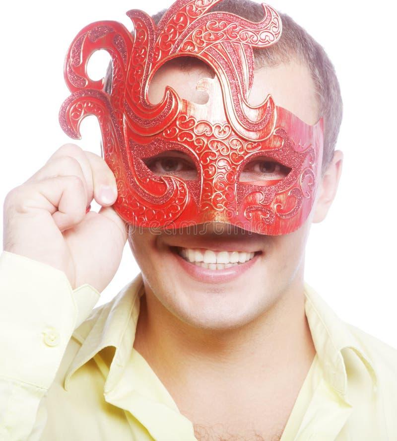 Portret van de jonge mens met Carnaval-masker royalty-vrije stock foto