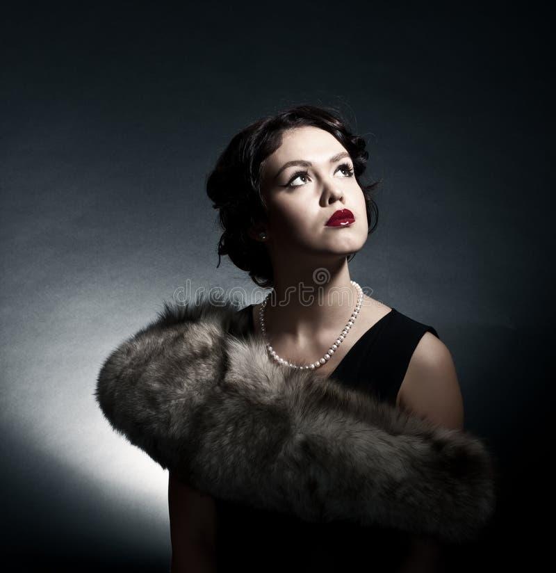 Portret van de jonge vrouw in stijl van retro royalty-vrije stock foto's