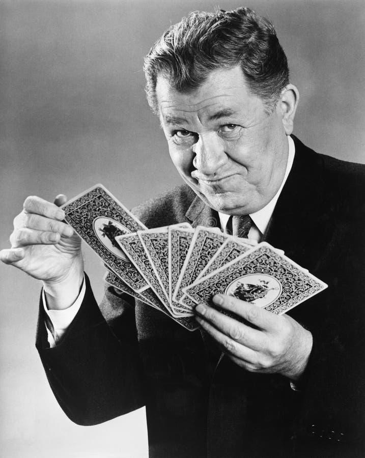 Portret van de mens met grote kaarten royalty-vrije stock afbeeldingen