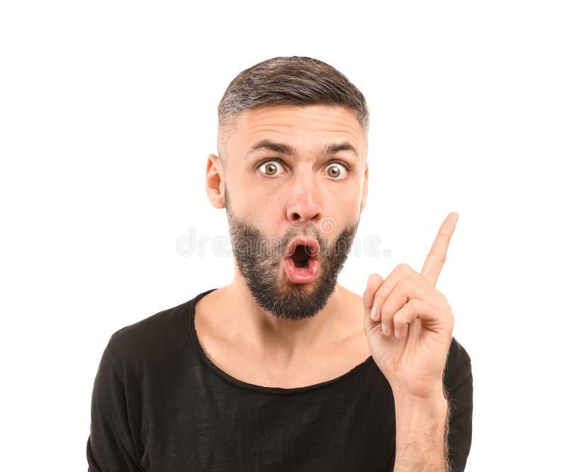 Portret van de mens met opgeheven wijsvinger op witte achtergrond royalty-vrije stock foto
