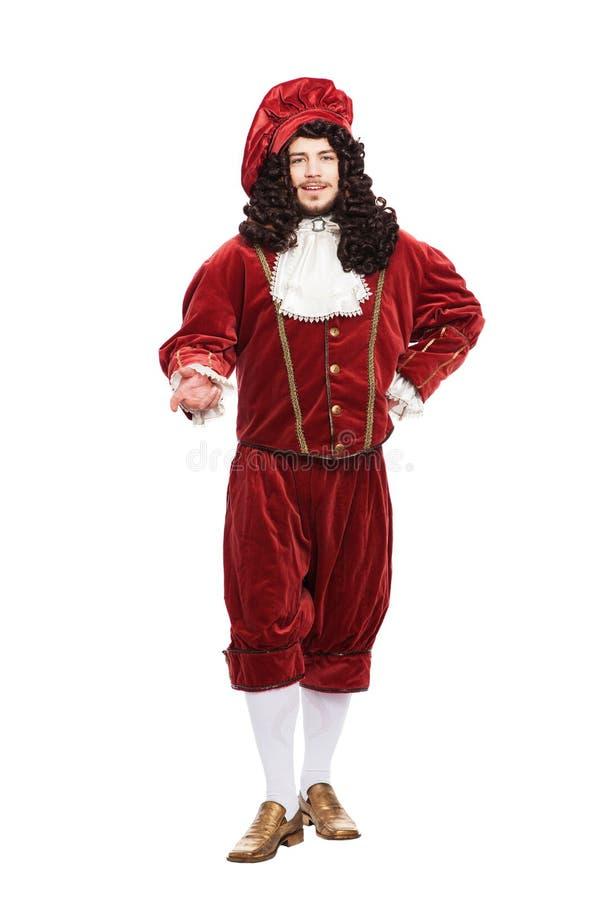 Portret van de Middeleeuwenman in rood kostuum stock afbeeldingen