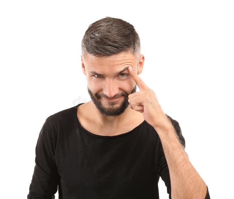 Portret van de sluwe knappe mens op witte achtergrond royalty-vrije stock afbeeldingen