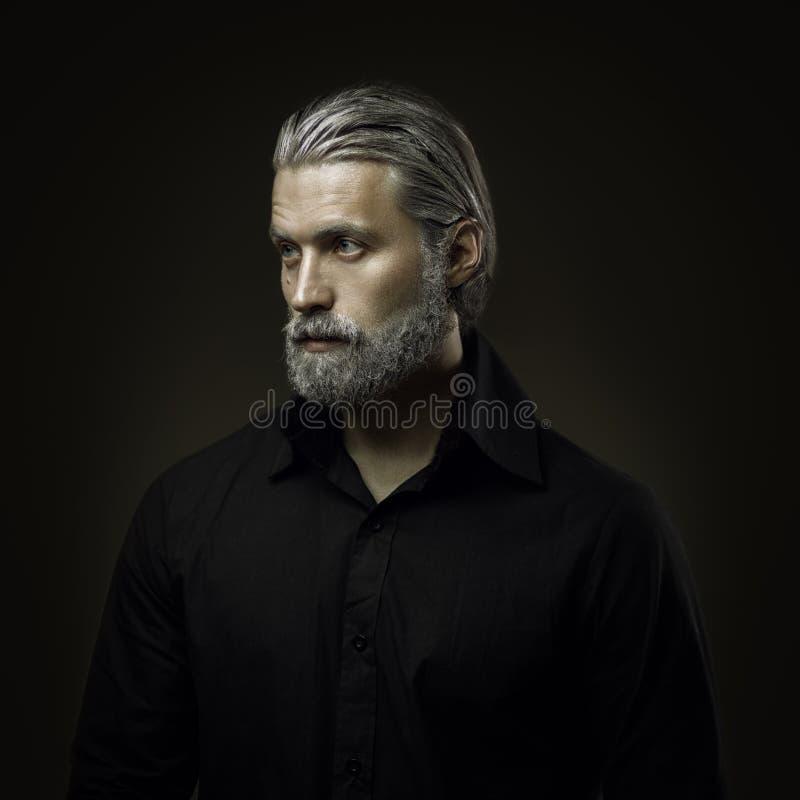 Portret van de taaie oude mens stock foto