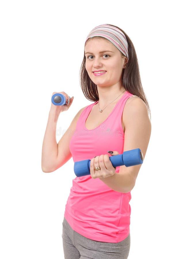 Portret van de vrij sportieve gewichten van de meisjesholding stock afbeeldingen