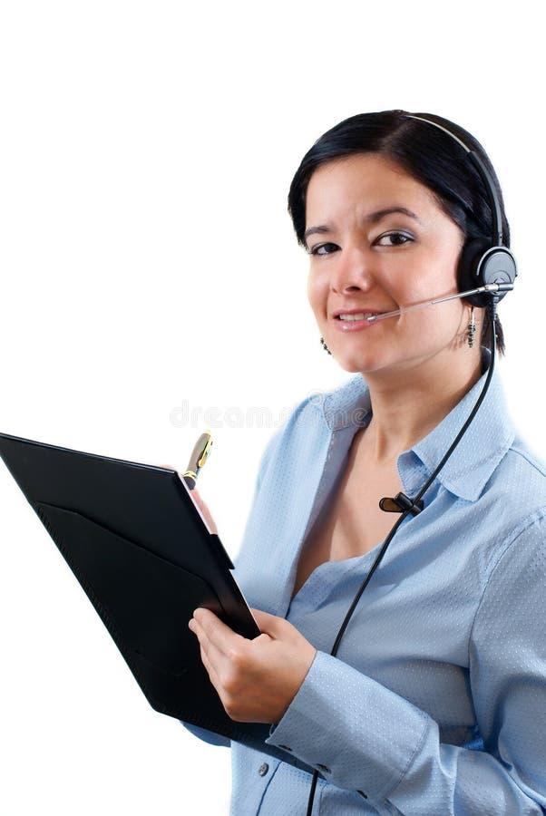 Portret van de vrouw van de klantendienst met stootkussen royalty-vrije stock afbeeldingen