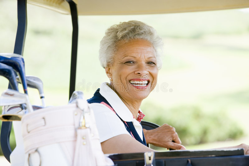 Portret van de Zitting van de Vrouw in een Kar van het Golf stock foto