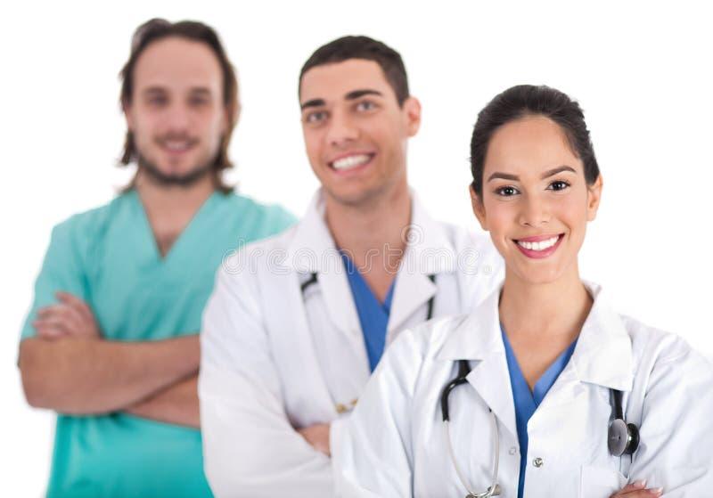 Portret van drie artsen in het ziekenhuis stock foto's