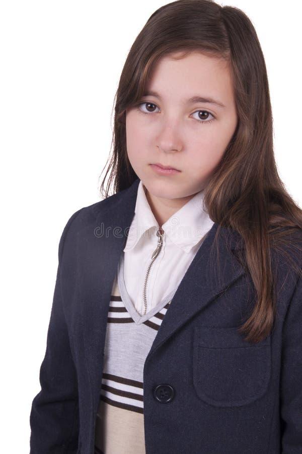 Portret van droevig schoolmeisje met eenvormig stock foto's