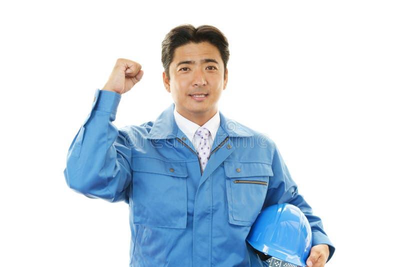 Portret van een arbeider met bouwvakker stock fotografie