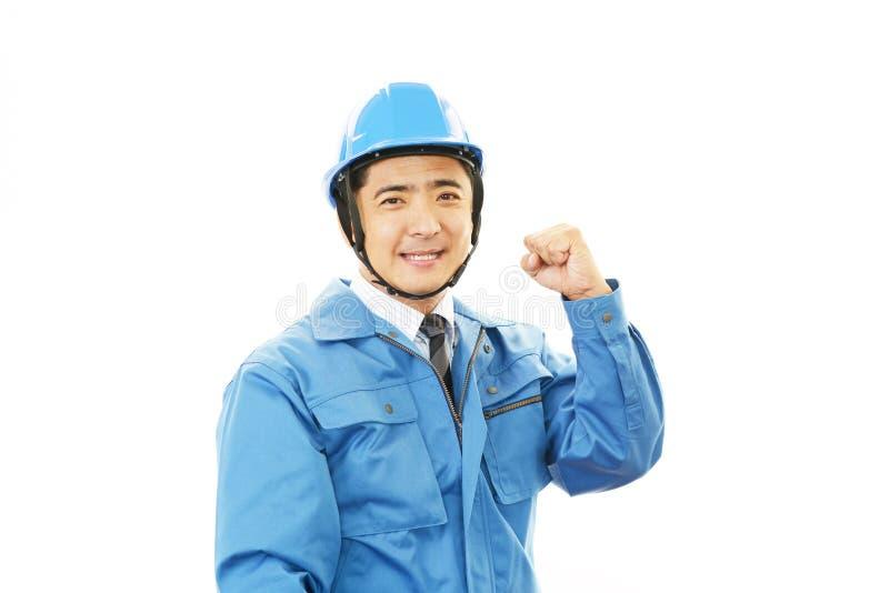Portret van een arbeider met bouwvakker royalty-vrije stock afbeelding