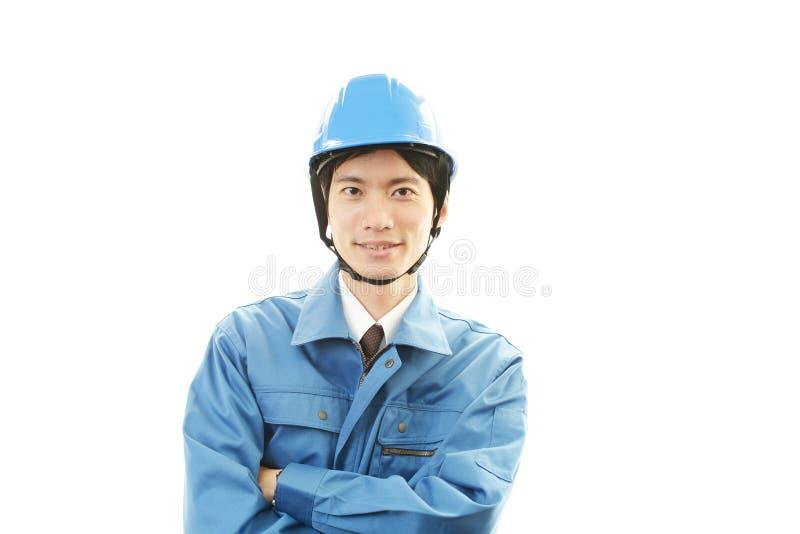 Portret van een arbeider met bouwvakker stock afbeeldingen