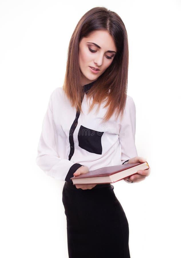 Portret van een bedrijfsdievrouw op witte achtergrond wordt geïsoleerd stock afbeelding