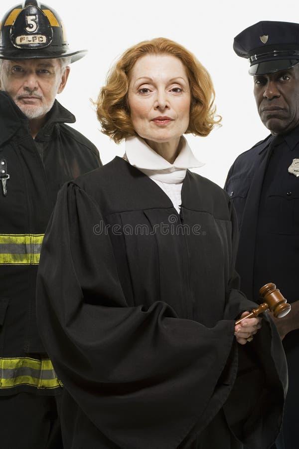 Portret van een brandbestrijder een rechter en een politieman stock fotografie