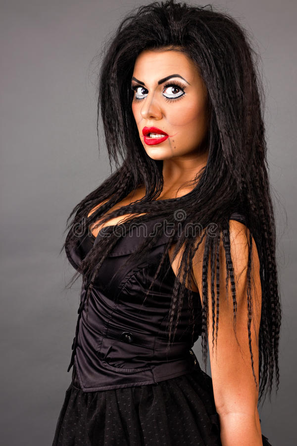 Portret van een expressieve jonge vrouw met creatieve make-up royalty-vrije stock foto's