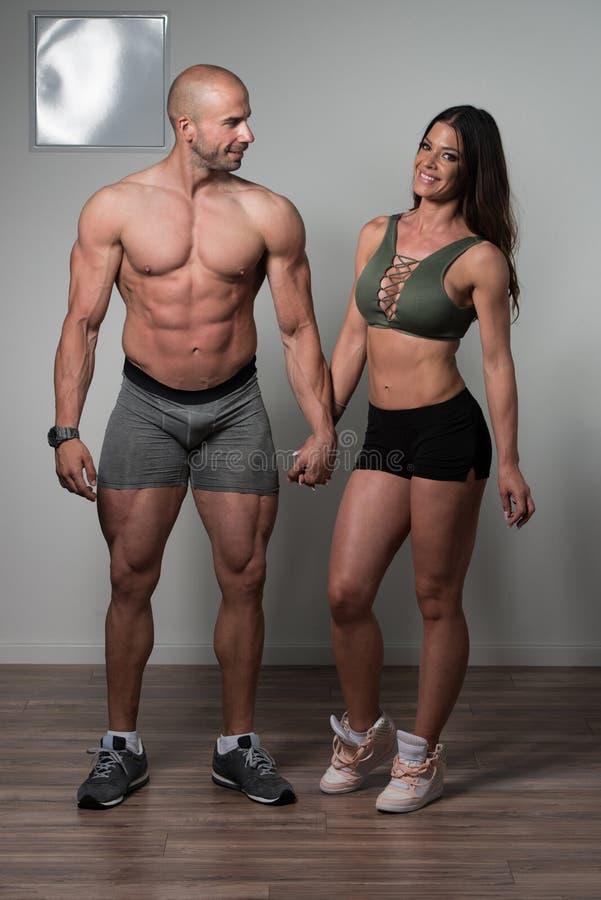 Portret van een fysisch Geschikt Spierpaar stock foto
