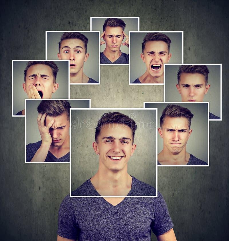 Portret van een gelukkige gemaskeerde jonge mens die verschillende emoties uitdrukken stock foto