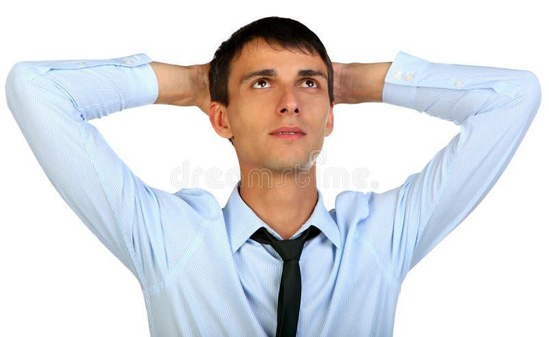 Portret van een gelukkige jonge mens die upwards in gedachte kijken royalty-vrije stock foto's