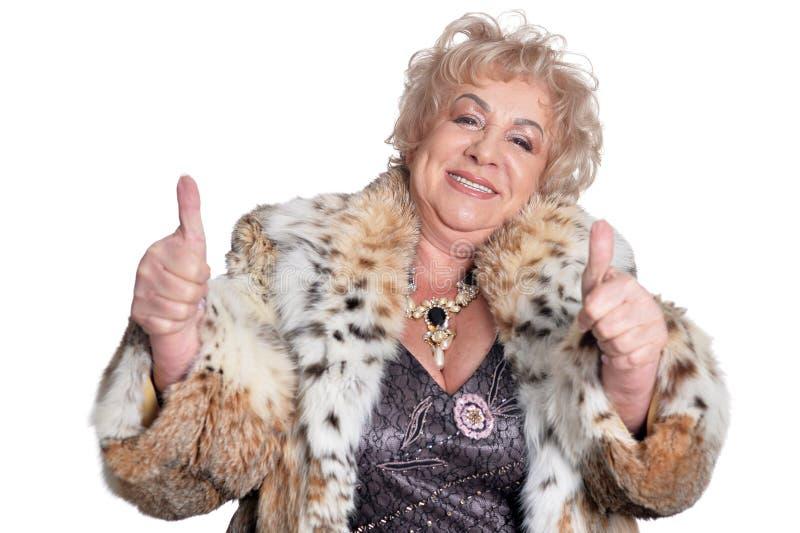 Portret van een gelukkige schitterende rijpe vrouw stock foto