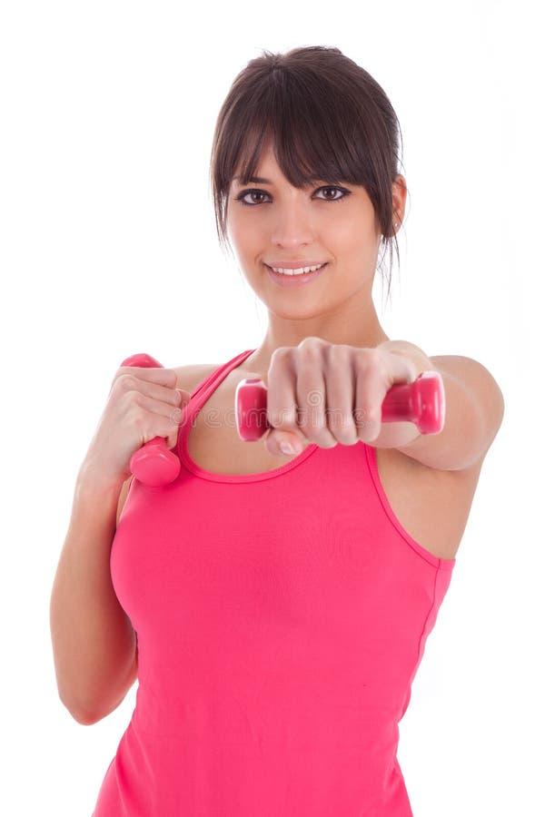 Portret van een geschiktheidsvrouw die met vrije gewichten uitwerken stock foto's