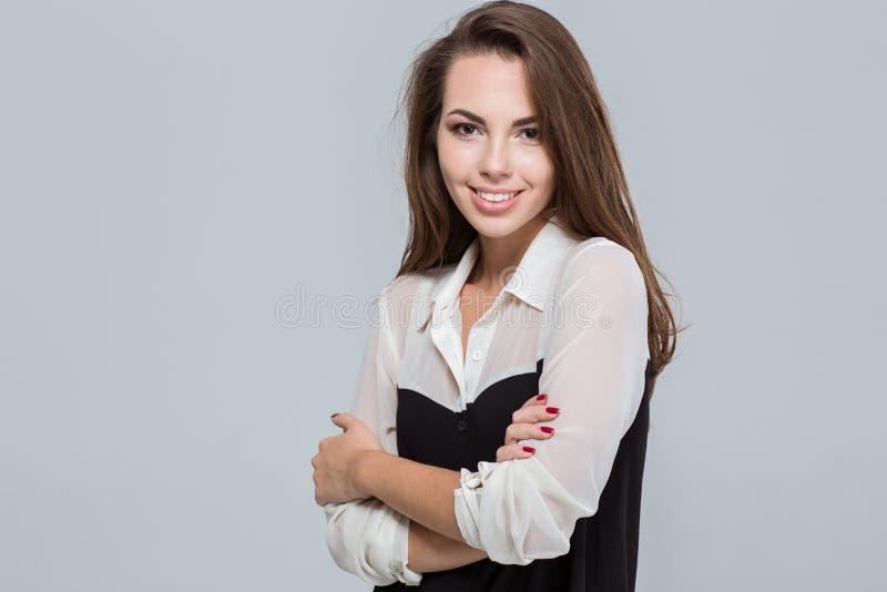 Portret van een glimlachende jonge onderneemster stock afbeeldingen