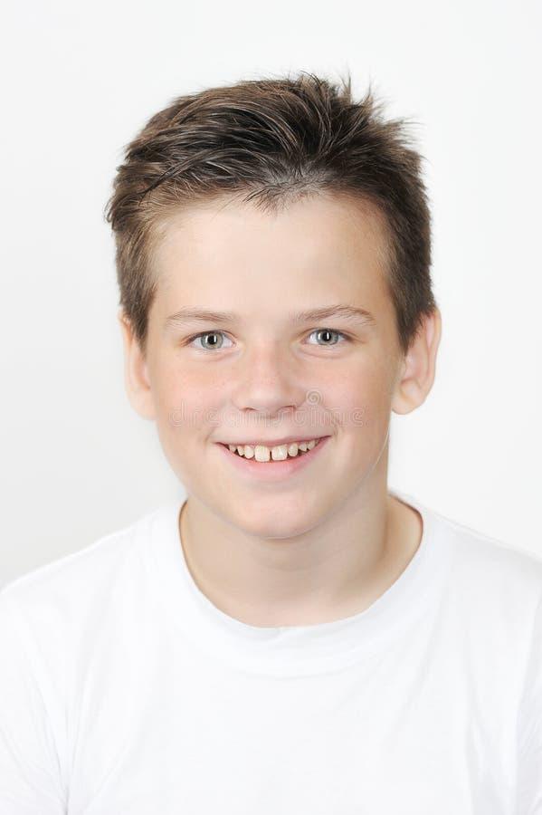 Portret van een glimlachende jongen 11 jaar van oude I stock afbeelding